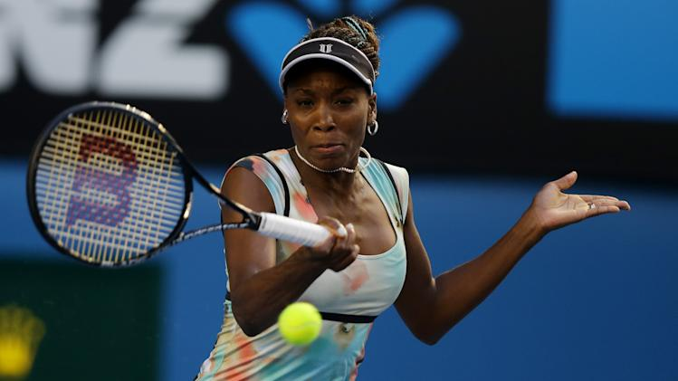 Venus Williams of the US makes a forehand return to Russia's Maria Sharapova during their third round match at the Australian Open tennis championship in Melbourne, Australia, Friday, Jan. 18, 2013. (AP Photo/Dita Alangkara)