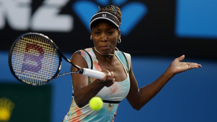 Venus Williams of the US makes a forehand return to Russia's Maria Sharapova during their third round match at the Australian Open tennis championship in Melbourne, Australia, Friday, Jan. 18, 2013. (AP Photo/Dita Alangkara)