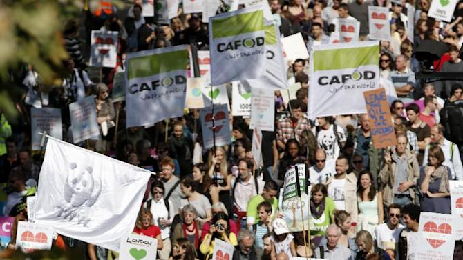Demonstrators display placards and banners as they participate in the Peoples Climate March in London on September 21, 2014