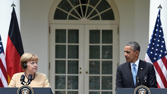 US President Barack Obama (R) and German Chancellor Angela Merkel during a press conference at the Rose Garden of the White House on May 2, 2014 in Washington, DC