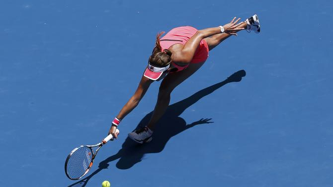 Goerges of Germany hits a return to Makarova of Russia during their women's singles match at the Australian Open 2015 tennis tournament in Melbourne