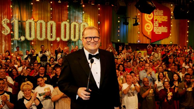"""FILE - In this February 2008 publicity image released by CBS Entertainment, host Drew Carey hosts pauses during a taping of of """"The Price is Right Million Dollar Spectacular,"""" one of six new specials to be broadcast on the CBS Television Network. A Los Angeles judge on Tuesday, March 12, 2013, overturned an $8.5 million jury verdict awarded to a former model on the show after determining that he had not properly instructed the panel. A retrial will be scheduled in Brandi Cochran's case versus the show's producers. (AP Photo/CBS, Monty Brinton, File) ** MANDATORY CREDIT. NO ARCHIVE. NO SALES. NORTH AMERICA USE ONLY. **"""