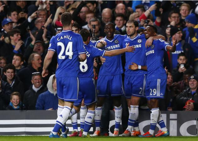 Chelsea's Eto'o celebrates with team mates after scoring his side's second goal during their English Premier League soccer match against Manchester United at Stamford Bridge