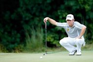 Louis Oosthuizen of South Africa lines up a putt during the second round of the Deutsche Bank Championship at TPC Boston in Norton, Massachusetts