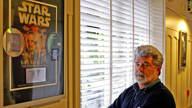 "FILE - In this May 4, 2005 file photo, George Lucas, director of ""Star Wars Episode III: Revenge of the Sith,"" poses at Skywalker Ranch in San Rafael, Calif. The film is the last in Lucas' series of ""Star Wars"" movies. There's no mistaking the similarities. A childhood on a dusty farm, a love of fast vehicles, a rebel who battles an overpowering empire, George Lucas is the hero he created, Luke Skywalker. (AP Photo/Eric Risberg, File)"