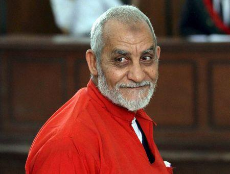Mohamed Badie, top leader of Egypt's outlawed Muslim Brotherhood, talks during a trial hearing alleging his involvement in a 2013 attack on a Port Said police station, at a court in Cairo