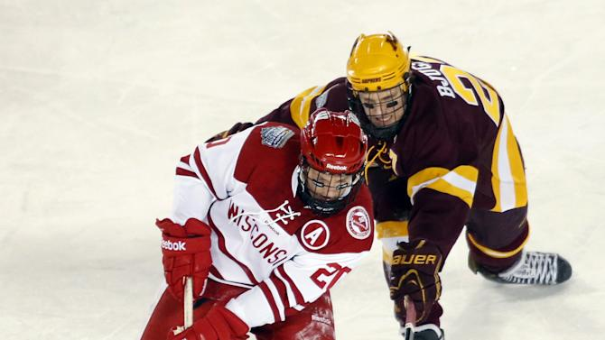 Wisconsin forward Ryan Little (20) controls the puck as Minnesota forward Nick Bjugstad pursues during the third period of a college hockey game at Chicago's Soldier Field, Sunday, Feb. 17, 2013. Wisconsin won 3-2. (AP Photo/Charles Rex Arbogast)