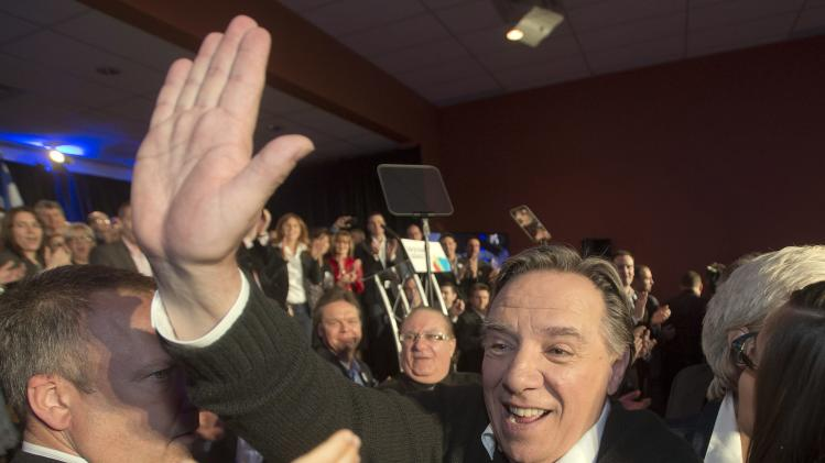Coalition Avenir du Quebec leader Francois Legault greets supporters at a rally on Sunday, March 16, 2014, in Repentigny, Quebec. (AP Photo/The Canadian Press, Ryan Remiorz)