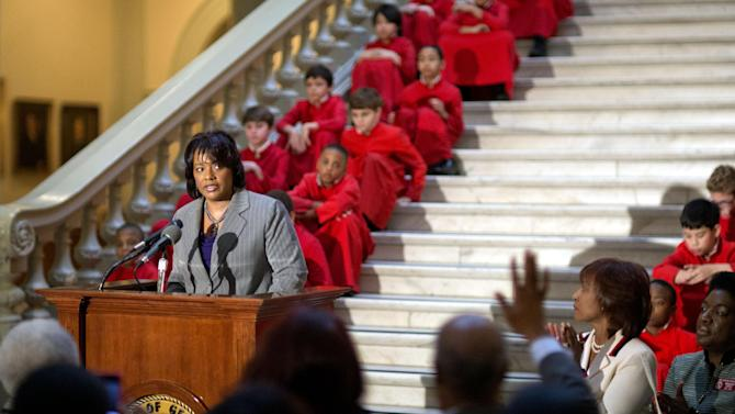 """In this Thursday, Jan. 17, 2013 photo, Bernice King, the daughter of Rev. Martin Luther King Jr., speaks during a service celebrating his birthday inside the Georgia State Capitol, in Atlanta. One of Rev. Martin Luther King Jr.'s quotes has been cited as one of America's essential ideals, its language suggestive of a constitutional amendment on equality: """"I have a dream that my four little children will one day live in a nation where they will not be judged by the color of their skin but by the content of their character."""" Yet today, 50 years after the Rev. Martin Luther King Jr.'s monumental statement, there is considerable disagreement over what this quote means when it comes to affirmative action and other measures aimed at helping the disadvantaged. (AP Photo/David Goldman)"""