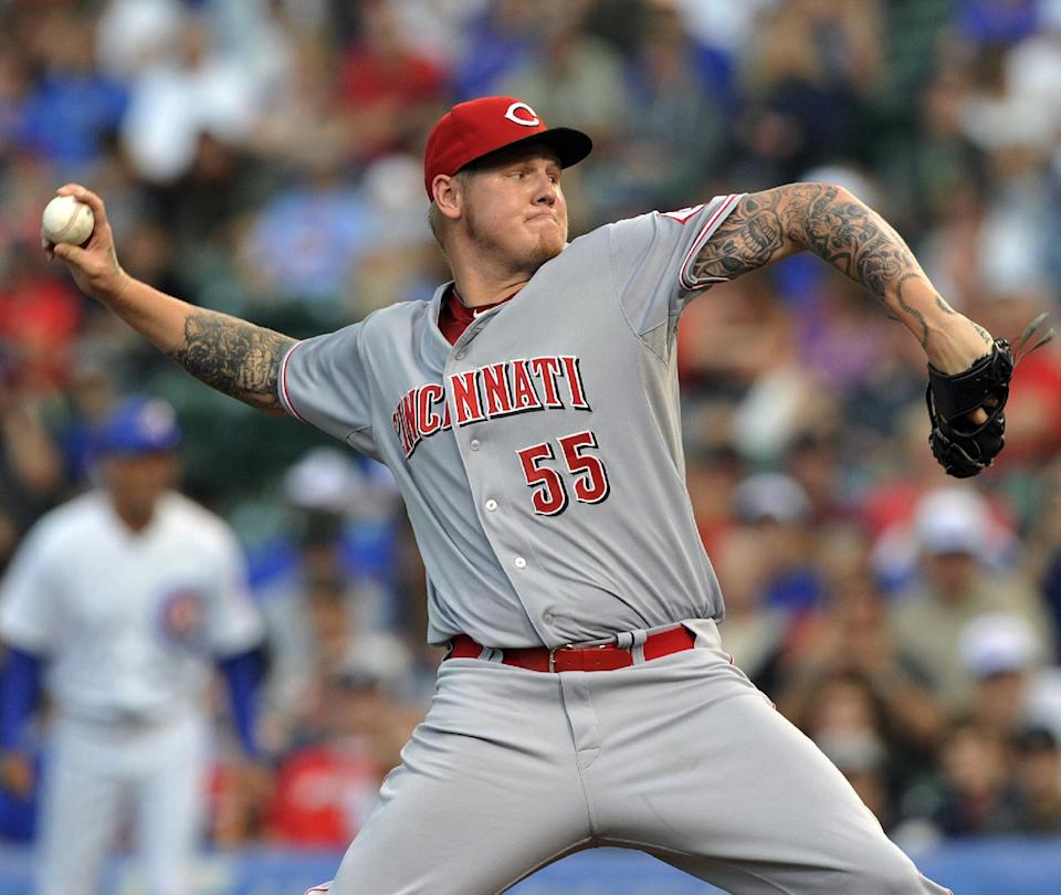 Latos blanks Cubs for 8 innings in Reds' 2-0 win