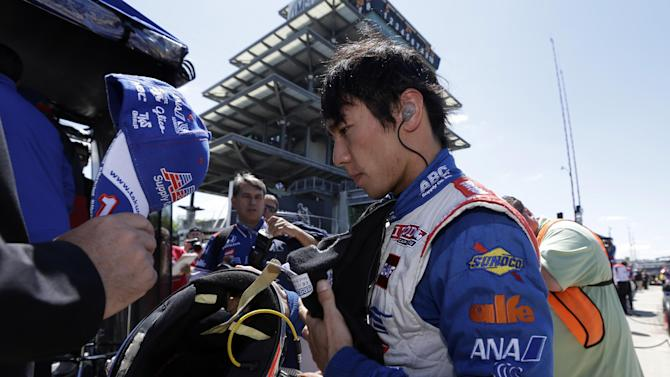 Takuma Sato, of Japan, removes his helmet following the final practice session for the Indianapolis 500 auto race at the Indianapolis Motor Speedway in Indianapolis, Friday, May 24, 2013. (AP Photo/Darron Cummings)