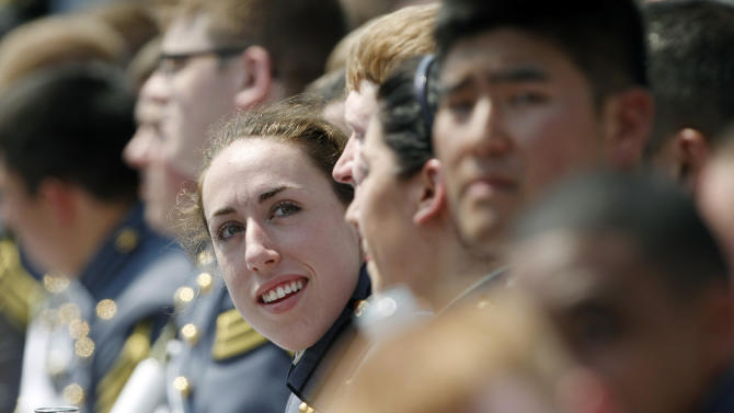 In this Saturday, May 26, 2012 photo, Kaitlyn Kelly reacts after a graduation and commissioning ceremony at the U.S. Military Academy in West Point, N.Y. At West Point, the alumni gay advocacy group Knights Out was able to hold the first installment in March of what is intended to be an annual dinner in recognition of gay and lesbian graduates and cadets. Kelly was among the dozens of cadets who attended the privately sponsored dinner. The 22-year-old Chicago resident was finally able to openly introduce her civilian girlfriend at an event marking 100 days before graduation. (AP Photo/Mike Groll)