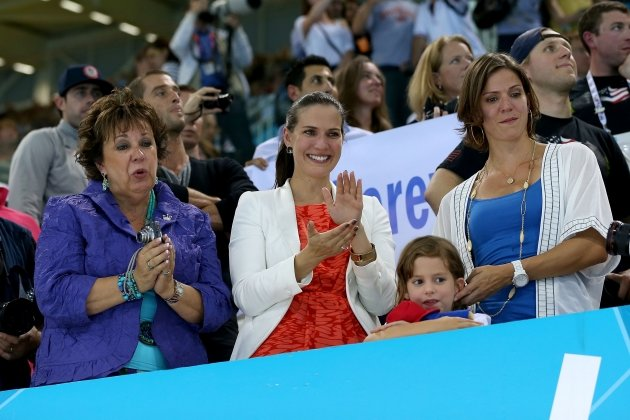 Mother of gold medallist Michael Phelps of the United States, Debbie Phelps(L) and his sisters Hilary (C) and Whitney (R) watch the medal ceremony for the Men&#39;s 4x100m medley Relay Final on Day 8 of the London 2012 Olympic Games at the Aquatics Centre on August 4, 2012 -- Getty Images
