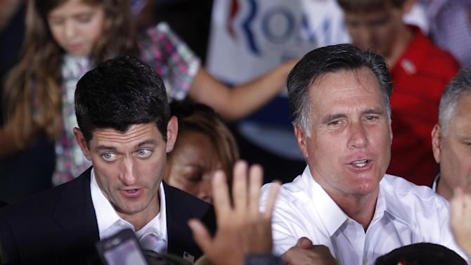 Republican presidential candidate, former Massachusetts Gov. Mitt Romney, right, and his newly announced vice presidential running mate, Rep. Paul Ryan, R-Wis., left, greet supporters during a campaign rally in Manassas, Va., Saturday, Aug. 11, 2012. (AP Photo/Pablo Martinez Monsivais)