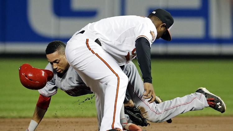 Cincinnati Reds' Billy Hamilton, back, beats a tag by Baltimore Orioles second baseman Jonathan Schoop as he steals second in the first inning of an interleague baseball game, Tuesday, Sept. 2, 2014, in Baltimore. (AP Photo/Patrick Semansky)