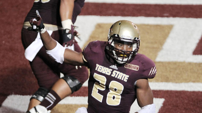 Texas State's Marcus Curry celebrates a touchdown during the first half of an NCAA college football game against Louisiana Tech, Saturday, Nov. 10, 2012, at Texas State University in San Marcos, Texas. (AP Photo/Darren Abate)