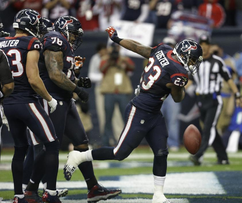 Houston Texans running back Arian Foster (23) celebrates his one-yard touchdown run against the Cincinnati Bengals during the third quarter of an NFL wild card playoff football game Saturday, Jan. 5, 2013, in Houston. (AP Photo/Eric Gay)