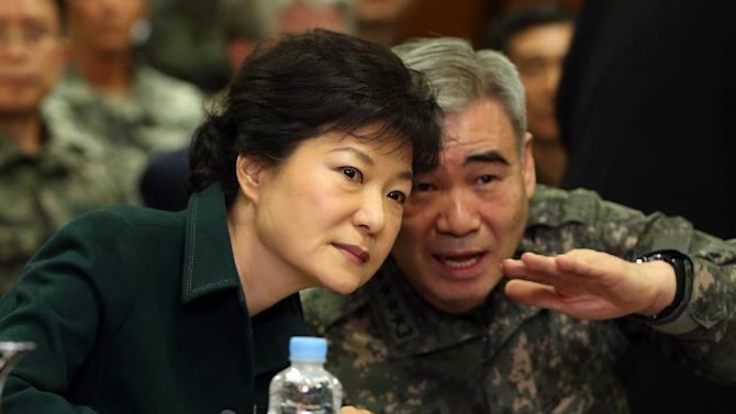 In this Feb. 22, 2013 photo, South Korean President-elect Park Geun-hye, left, listens to Deputy commander, Republic of Korea-U.S. Combined Forces Command Gen. Kwon Oh-sung during her visit at the Combined Forces Command in Seoul, South Korea. Even before she takes office Monday, Feb. 25, 2013, as South Korea's first female president, Park's campaign vow to soften Seoul's current hard-line approach to rival North Korea is being tested by Pyongyang's recent underground nuclear detonation. Pyongyang, Washington, Beijing and Tokyo are all watching to see if Park, the daughter of a staunchly anti-communist dictator, pursues an ambitious engagement policy meant to ease five years of animosity on the divided peninsula or if she sticks with the tough stance of her fellow conservative predecessor, Lee Myung-bak. (AP Photo/Yonhap) KOREA OUT