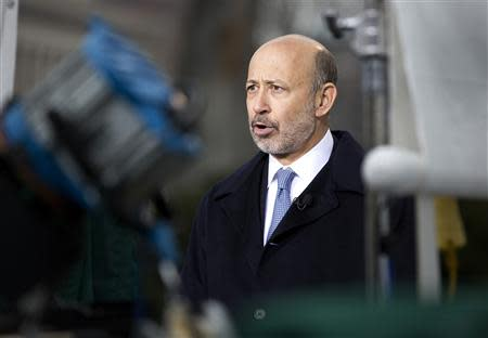 Lloyd Blankfein, Chairman and CEO, Goldman Sachs Group, speaks with the media after meeting with U.S. President Barack Obama and other CEOs at the White House in Washington