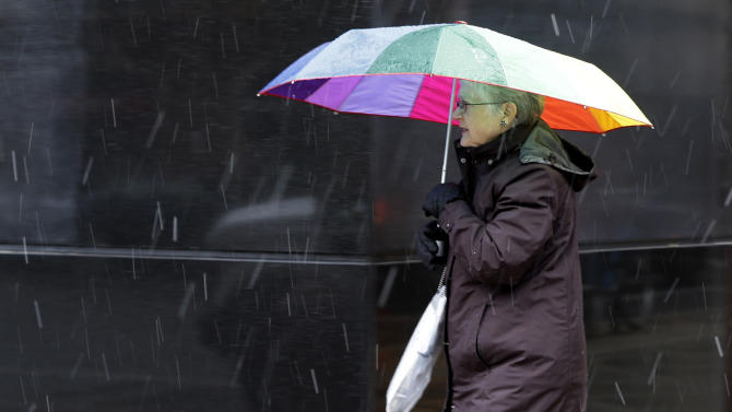 A pedestrian walks along Broad Street through a nor'easter, Wednesday, Nov. 7, 2012, in Philadelphia. The storm was expected to bring a combination of wind-blown snow, sleet and freezing rain to eastern Pennsylvania later Wednesday and into Thursday morning, with snow accumulations of 3 to 5 inches possible, the National Weather Service said. (AP Photo/Matt Slocum)