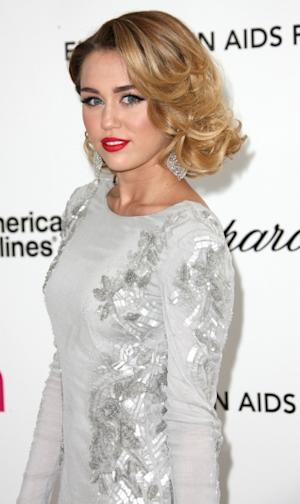Miley Cyrus arrives at the 20th Annual Elton John AIDS Foundation's Oscar Viewing Party held at West Hollywood Park in West Hollywood, Calif. on February 26, 2012 -- Getty Images