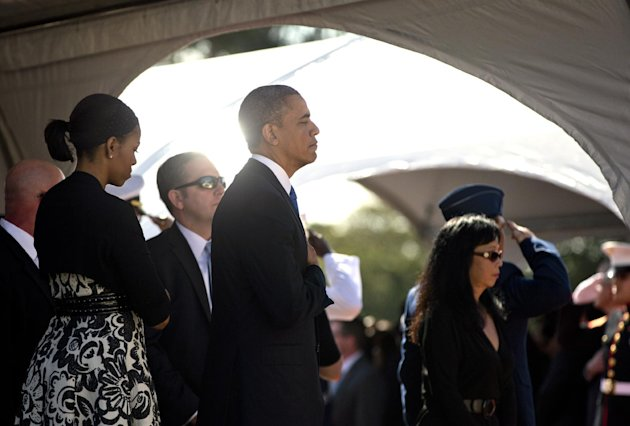 President Barack Obama and First Lady Michelle Obama attend a memorial service for the late Sen. Daniel Inouye, D-Hawaii, at the National Memorial Cemetery of the Pacific, Sunday, Dec. 23, 2012, in Honolulu. (AP Photo/Carolyn Kaster)
