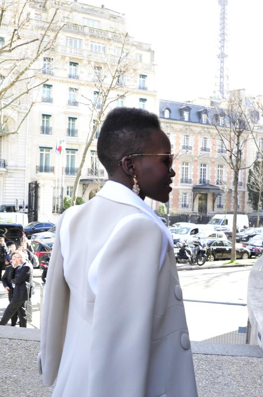 Actress Lupita Nyong'o arrives at Miu Miu's ready to wear fall/winter 2014-2015 fashion collection presented in Paris, Wednesday, March 5, 2014. (AP Photo/Zacharie Scheurer)