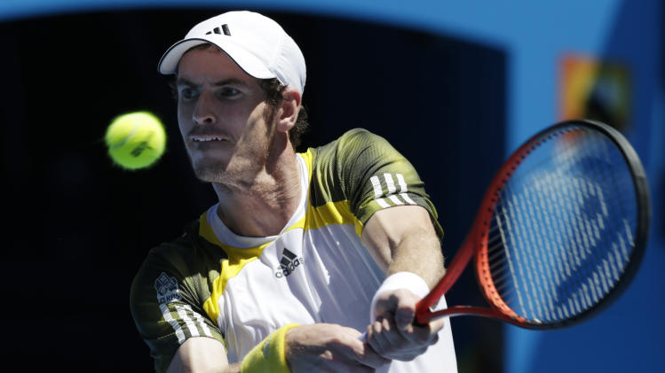 Britain's Andy Murray makes a backhand return to Robin Haase of the Netherlands during their first round match at the Australian Open tennis championship in Melbourne, Australia, Tuesday, Jan. 15, 2013. (AP Photo/Andy Wong)