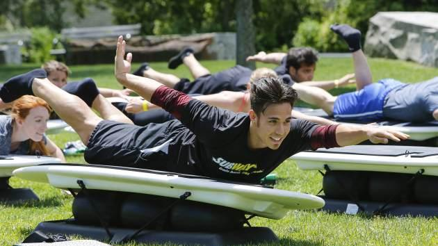 Apolo Ohno shows off the surfboard exercise Surfset during a fitness event in NYC --