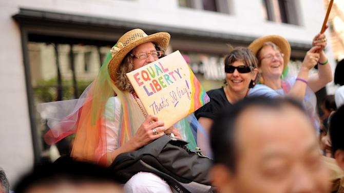 Elizabeth Jay holds a sign championing same-sex marriage during San Francisco's 43rd annual gay pride parade Sunday, June 30, 2013. (AP Photo/Noah Berger)