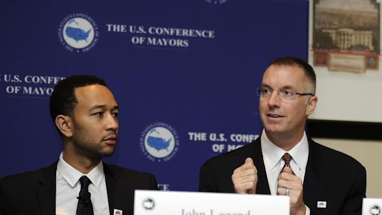 From left to right, musician John Legend; Craig Hagen, Senior Director of Government Affairs at Electronic Arts, Inc.speak during a panel on STEM education and the announcement of SimCity EDU by EA Maxis at the National Conference of Mayors, Friday, Jan. 18, 2013, in Washington. (Photo/Nick Wass/Invision for EA)