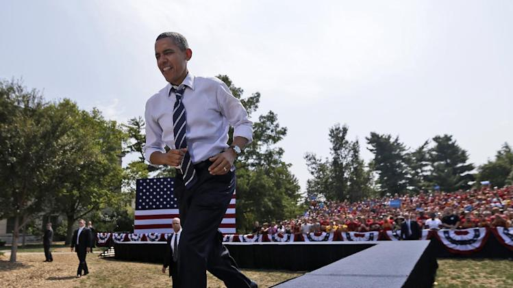 President Barack Obama walks on stage to speak for a campaign event at Iowa State University, Tuesday, Aug. 28, 2012, in Ames, Iowa. (AP Photo/Pablo Martinez Monsivais)