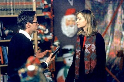"Larry (Robert Downey Jr., L) and Ally (Calista Flockhart, R) try to figure out what to do with an unexpected Christmas visit on ""The Man With The Bag"" episode of Ally McBeal Ally McBeal"
