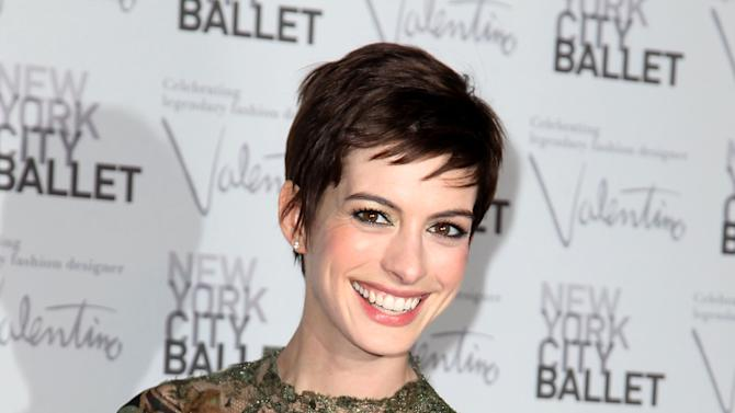 """This Sept. 20, 2012 photo released by Starpix shows actress Anne Hathaway arrives at the New York City Ballet Fall Gala honoring fashion designer Valentino Garavani at Lincoln Center in New York. Hathaway will perform songs from the musical """"Caberet"""" for a one-night only appearance titled, """"Perfectly Marvelous: The Songs of Cabaret with Anne Hathaway and Friends,"""" on Wednesday, Oct. 24 at 7 p.m. at Joe's Pub in New York to support The Public Theater's revitalization of its downtown home at Astor Place. (AP Photo/Starpix, Amanda Schwab, file)"""