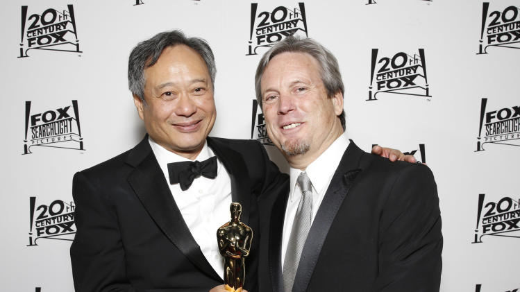 Director Ang Lee and Producer Gil Netter attend the Twentieth Century Fox And Fox Searchlight Pictures Academy Awards Nominees Party at Lure on Sunday, February 24, 2013 in Los Angeles. (Photo by Todd Williamson/Invision for Fox Searchlight/AP)