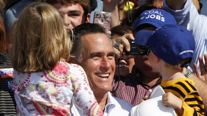 FILE - In this Oct. 5, 2012 file photo, Republican presidential candidate, former Massachusetts Gov. Mitt Romney holds a couple of children during a rally in Abingdon, Va. It's not just President Barack Obama's lackluster debate that has some Democrats on edge less than a month from Election Day. Party loyalists, both in Washington and in battleground states, fret that Obama's campaign isn't aggressive enough in blocking Romney's pivot to the political center, and they fear Romney's new efforts to show a softer side give him an opening with female voters. (AP Photo/Steve Helber)