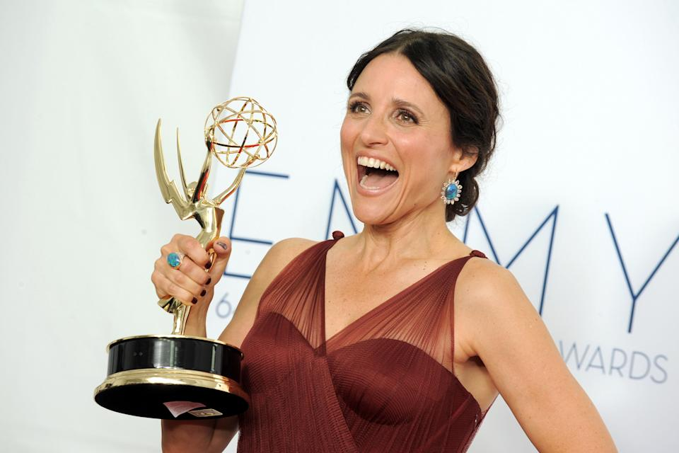 Actress Julia Louis-Dreyfus, winner Outstanding Lead Actress in a Comedy Series poses backstage at the 64th Primetime Emmy Awards at the Nokia Theatre on Sunday, Sept. 23, 2012, in Los Angeles. (Photo by Jordan Strauss/Invision/AP)