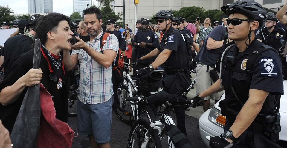 Occupy Demonstrators shout at police during an unscheduled protest march, Tuesday, Sept. 4, 2012, in Charlotte, N.C. The Democratic National Convention begins today. (AP Photo/Mike Stewart)