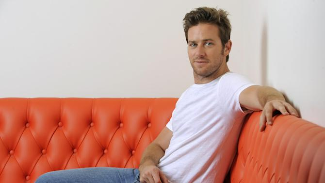 """In this Monday, June 10, 2013 photo, actor Armie Hammer poses for a portrait at the Pacific Design Center in West Hollywood, Calif. Hammer takes on his first major leading-man role opposite Johnny Depp in """"The Lone Ranger."""" The movie releases July 3, 2013. (Photo by Chris Pizzello/Invision/AP)"""