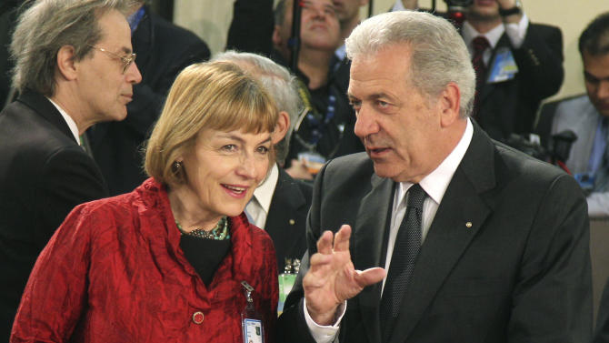 Croatia's Foreign Minister Vesna Pusic, left, talks with her Greek counterpart Dimitrios Avramopoulos, during a NATO foreign ministers meeting at NATO headquarters in Brussels, Tuesday, April 23, 2013. Foreign ministers from the 28 NATO countries are meeting in Brussels to discuss the wars in Syria and Afghanistan, and to learn the views of a new member of their club — U.S. Secretary of State John Kerry.  (AP Photo/Yves Logghe)