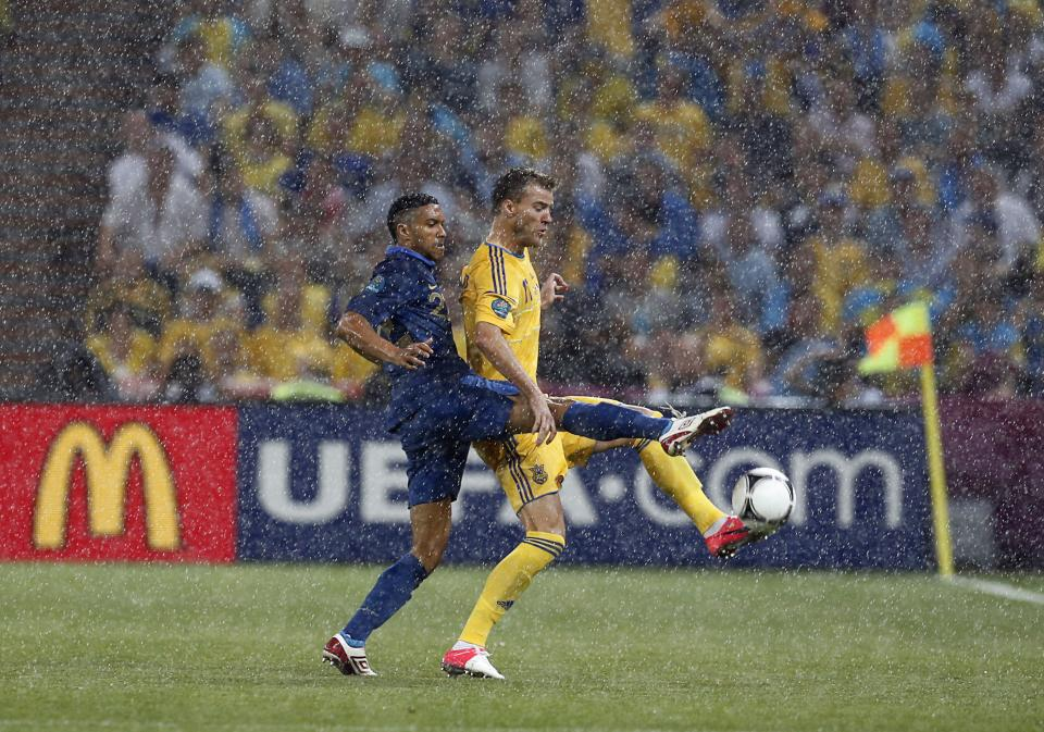 France's Gael Clichy, left, and Ukraine's Andriy Yarmolenko fight for the ball during the Euro 2012 soccer championship Group D match between Ukraine and France in Donetsk, Ukraine, Friday, June 15, 2012. (AP Photo/Matthias Schrader)