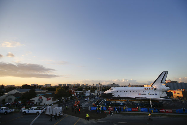 The space shuttle Endeavour sits in a strip mall near Los Angeles International Airport in Los Angeles, Friday, Oct. 12, 2012. Endeavour's 12-mile road trip kicked off shortly before midnight Thursday