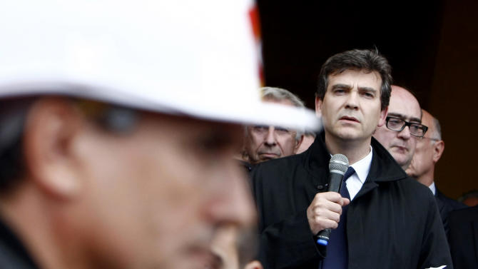 FILE - In this Sept. 27, 2012 file photo, French Minister for Industrial Recovery Arnaud Montebourg delivers a speech after meeting workers and trade union representatives of ArcelorMittal, in Florange, northeast France. Montebourg said Monday Nov. 26, 2012 that he wants international steel giant ArcelorMittal out of the country. (AP Photo/Mathieu Cugnot, File)