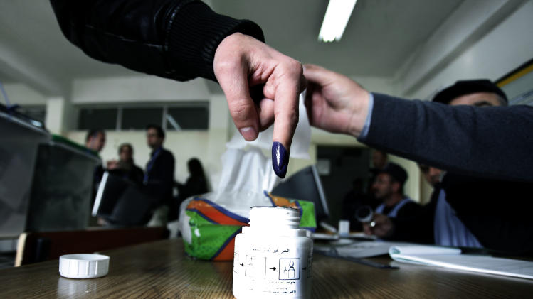 A Jordanian woman inks his finger after casting his vote inside a polling station in Amman, Jordan, Wednesday, Jan. 23, 2013. Jordanians voted Wednesday in a first electoral test for their king's political reforms, while a boycott from his Islamist-led opponents cast doubt over whether the vote would quell two years of simmering dissent in the streets. (AP Photo/Mohammad Hannon)