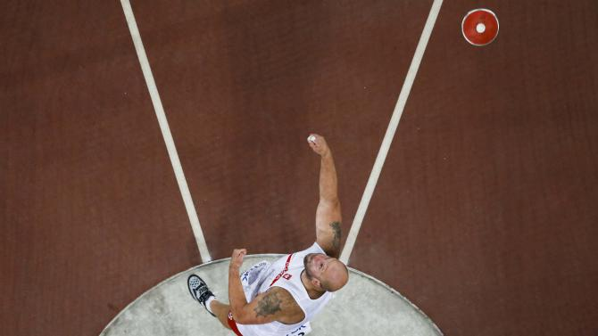 Malachowski of Poland competes in the men's discus throw final at the 15th IAAF World Championships at the National Stadium in Beijing