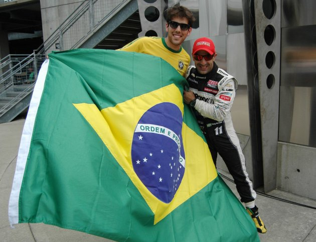 KV Racing Technology driver Tony Kanaan of Brazil poses for a photo with a race fan after qualifying for the Indianapolis 500 at the Indianapolis Motor Speedway in Indianapolis