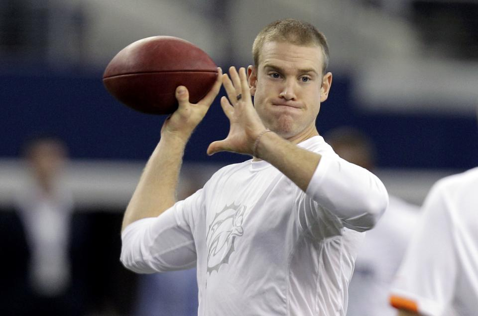 Miami Dolphins quarterback Ryan Tannehill (17) warms up before a preseason NFL football game against the Dallas Cowboys, Wednesday, Aug. 29, 2012, in Arlington, Texas. (AP Photo/LM Otero)
