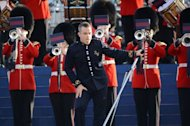 British singer-songwriter Robbie Williams performs on stage during the Queen's Diamond Jubilee Concert at Buckingham Palace in London. Queen Elizabeth II smiled as she took her place for a star-studded diamond jubilee concert Monday, despite her husband's sudden hospitalisation