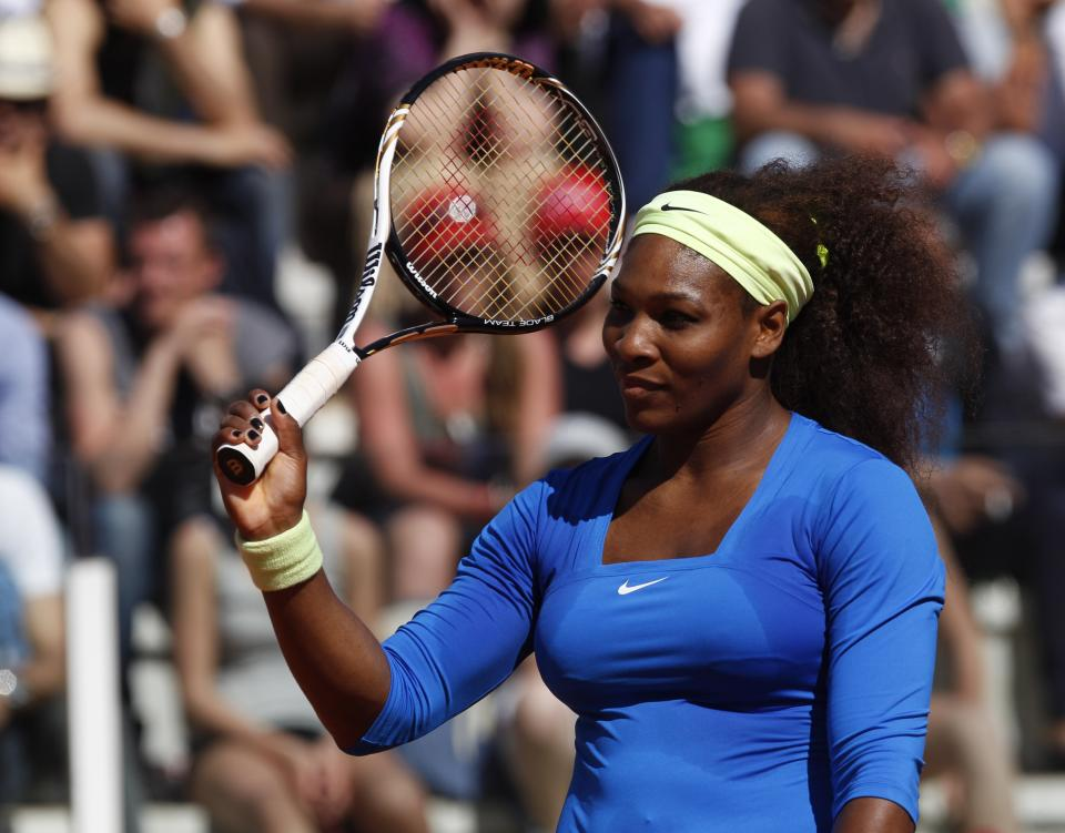 Serena Williams of the United States celebrates after winning a point during her match against Anabel Medina Garrigues of Spain at the Italian Open tennis tournament, in Rome, Thursday,  May 17, 2012. Serena Williams beat Anabel Medina Garrigues 6-3, 6-1.(AP Photo/Alessandra Tarantino)