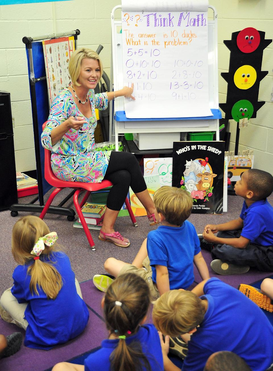 Deanna Jump, a first-grade teacher at Central Fellowship Christian Academy in Macon, Ga., instructs her students in math on Wednesday, September 12, 2012.  Jump, the top seller on the website teacherspayteachers.com, has been invited to multiple school systems across the country to share her teaching methods. (AP Photo/Todd Stone)